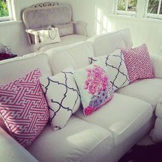 Patterned pillows on a neutral sofa brighten up a room and allow you to make changes on with out spending a fortune!