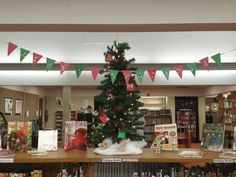 Merry Craftmas library Christmas and crafting book display with advent calendar and monogrammed ornaments to advertise craft program.