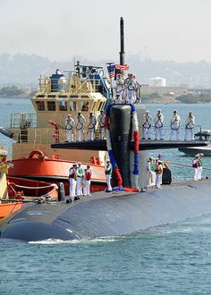 SAN DIEGO (Aug. 21, 2013) The Los Angeles-class attack submarine USS Albuquerque (SSN 706) is guided in by tugs as it returns to Naval Base Point Loma following a seven-month deployment to the western Pacific region. (U.S. Navy photo by Mass Communication Specialist 2nd Class Kyle Carlstrom)