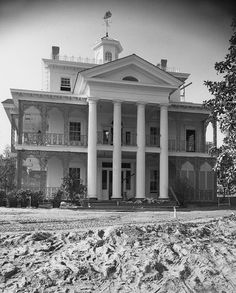 In 1962, construction began on the beautiful southern plantation-inspired home, and in the years that followed, as Imagineers developed (sometimes competing) themes and stories of a Haunted Mansion attraction, a sign was placed in front of its closed gates to tease what was (possibly) to come.