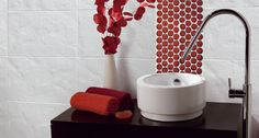 black, white, and red bathroom accessories with red circle accent tile... Red Bathroom Inspiration from Bathroom Bliss by Rotator Rod
