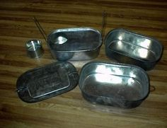 A Moveable Feast: The History of Early and Collectible American Lunchboxes - An early worker's sectional lunch tin.
