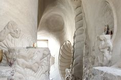 Windows of the Earth Cave Sanctuary. Hand-carved cave by Ra Paulette on the grounds of the Origin resort in Ojo Caliente, New Mexico. Reserve a cave tour for $20.