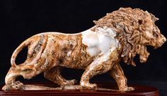 Jasper Lion Statue  - I want snarling lion statues on either side of my front door. Nothing quiet and kingly. I want it to frighten small children.