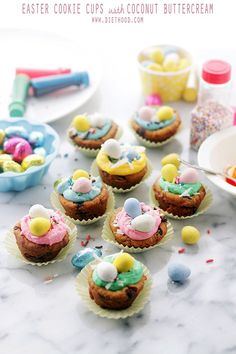 Easter Cookie Cups with Coconut Buttercream Frosting | www.diethood.com | Charming, colorful and bright Easter Cookie Cups filled with a sweet and luscious Coconut Buttercream Frosting. | #recipe #easter #buttercreamfrosting