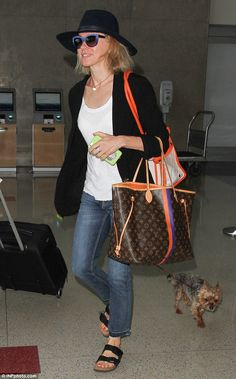 Cool and casual:Opting for a casual chic look, Naomi Watts sported a white T-shirt layered with a black blazer