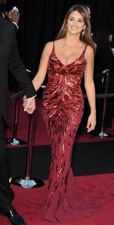 Penelope Cruz appeared absolutely exquisite when she arrived at the Academy Awards in a show-stopping red dress with knock-out sequin detailing in 2011.