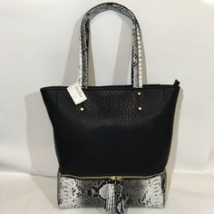 Black & White Python Embossed Tote Large tote has black body with black and white embossed Python bottom and handles. Interior has one large slip pocket, and a large zippered pocket with snap loop key keeper. Lower front has a functional zippered section for extra storage.  12 X 4 X 14 NWT Neiman Marcus Bags Totes