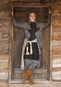 """Jersey cardigan in a really comfortable wraparound style. Just """"throw it on"""" and it can also be buttoned with two small buttons. Printed in the """"Tika"""" pattern with cuffs in the same pattern but in an accent color."""