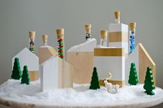 Make a modern Advent village using blocks of wood and test tubes filled with treats!