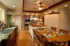 Elegant, compact kitchen with a wooden countertop and a matching four seater table