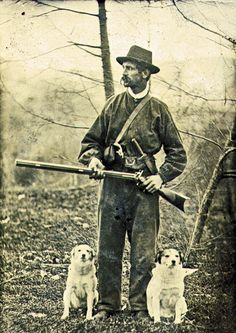 Accompanied by his attentive dogs in this circa 1865-70 tintype, this fellow is armed with a double rifle—or combination rifle-shotgun—with superposed barrels and percussion locks, a Bowie knife and what appears to be a small-cartridge deringer.  – Courtesy Dickinson Research Center, National Cowboy & Western Heritage Museum, 2002.113 –