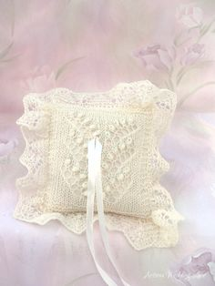 Hand-knitted elegant lace ring bearer pillow, inspired by Estonian lace knitting. It features the Lily of the valley lace pattern with small blue glass beads. By Artanis Wedding Lace