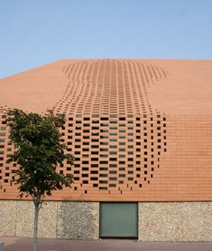 Pixelated brick skin exterior, Pope John Paul II Hall in Rijeka, Croatia, by Randić-Turato Architects.