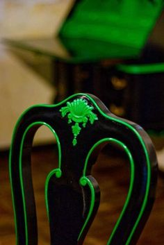 Neon trimmed chairs.... great idea for thrift store finds. Mismatched chairs painted black with different colored trim.