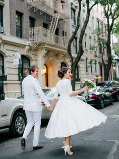 Beautiful tea length wedding dress in New York via http://www.greylikesweddings.com/real-weddings/destination-to-new-york-a-city-loft-wedding/