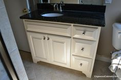A simple painted vanity with offset drawers.