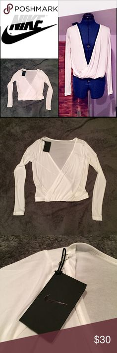 NWT Nike White Workout Top A pretty Nike moisture wicking workout top. Brand new with tag! Fitted on a mannequin measuring 33-26-36. Has a small hole in the shoulder that's hardly noticeable. Reasonable offers considered. Feel free to ask questions. No trades. Nike Tops