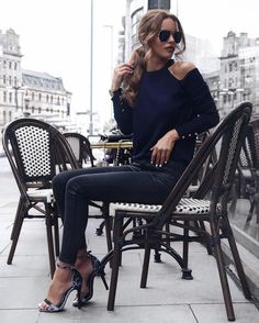 Nada Adelle is wearing all black; a classic choice when you desire a sleek and elegant aesthetic. Nada wears black jeans with a shoulderless top and striking stilettos. Shoes: 4th Hand Reckless.