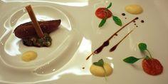 Lasarte, Barcelona: Roast pigeon, ragout of pork, tomato and lemon with apple cream, and 'interiors' toast