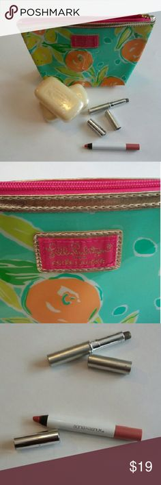 Lilly Pulitzer packet in like new condition Includes a Lilly Pulitzer midsize makeup bag, two fancy triple milled soaps, and a nice, new, upscale Sonia Kashuk retro pink lip pencil.  Bonus greyish-green rollon eyeshadow. See top of pic 3. Not sure what brand. Let me know if you don't want it. Bags Cosmetic Bags & Cases