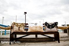 nautical chic, navy and tan pillows, wooden bench.