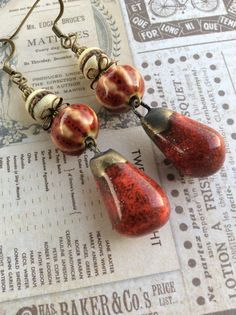 The Melting Pot...Artisan Earrings, Ceramic, Bohemian, Rustic Assemblage, Red, Bronze, Earthy, Primitive Pods, Unique, JustSlightlyVintage by JustSlightlyVintage on Etsy https://www.etsy.com/listing/515545988/the-melting-potartisan-earrings-ceramic