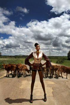 Two kenyan girls hitchhiking, but dressed to kill.
