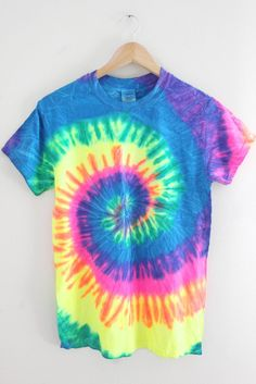 Bright neon rainbow swirl design tie-dyed on a 100% cotton t-shirt. Please note: Each tie-dyed tee is hand dyed and slightly unique. Washing instructions: Machine wash inside out in very cold water, d