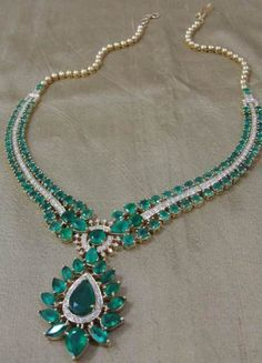 Classic emerald necklace- Classic emerald necklace with a streak of pave-set diamonds is handcrafted in 18 kt YG.