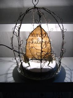 Globe cage with bird - linen provides cover and diffuses light from bulb  ******************************************  LesGlobesdeMaries - #cage #wire #bird #art #globes #light #crafts #lamp #heart - tå√
