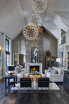 Light contemporary great room / living room with dark rustic wood floors, stone fireplace and orb chandeliers Home Living Room, Living Room Designs, Apartment Living, Minimal Apartment, High Ceiling Living Room, York Apartment, Apartment Furniture, House Furniture, Apartment Design