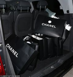 Designer diva: Miley Cyrus emerged from the expensive designer store with a trunkful of Chanel bags