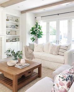 Light and bright living room features just rug, white slipcovered sofas, large w. - Home Elite - Indian Living Rooms Indian Living Rooms, Living Room Grey, Home Living Room, Living Room Furniture, Living Room Designs, Living Room Decor, Living Room Walls, Dining Rooms, Sala Indiana