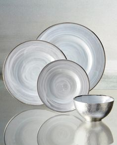 Polished modern silver dinnerware plates and bowls