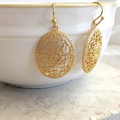 A personal favorite from my Etsy shop https://www.etsy.com/listing/452829876/gold-filigree-earrings-botanical