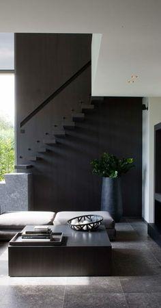 Pretty...like colors, greenery, zafu seating, simple w very cool stairs  Modern Home Living Area—Frederic Kielemoes |