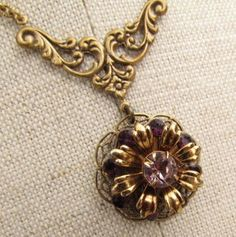 My Salvaged Treasures: January 2011  pendant was an earring, glued on to a filigree backing