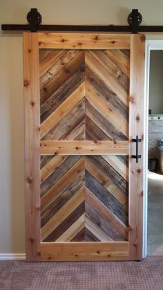 How to Build a Sliding Barn Door Want a rustic look with a homemade barn door? Build a DIY barn door with this step by step guide. Pallet Door, Barnwood Doors, Pallet Barn, Rustic Barn Doors, Barn Door Closet, Diy Sliding Barn Door, Sliding Doors, Bedroom Barn Door, Diy Barn Door Plans