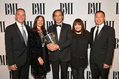 MAY 14, 2015 (L-R) BMI President and CEO Mike O'Neill, Laura Engel, honoree Alexandre Desplat, BMI Vice President of Film and Television Relations Doreen Ringer-Ross and Assistant Vice President, Film/TV Relations at BMI Ray Yee pose with the BMI Icon Award during the 2015 BMI Film & Television Awards at the Beverly Wilshire Hotel on May 13, 2015 in Beverly Hills, California. (Photo by Lester Cohen/Getty Images for BMI)