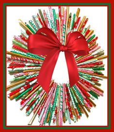 This wreath is made from rolled paper.  Something for children to make using glossy magazine pictures, calender photos, old Christmas wrap or cards etc. [Click on link for instructions]