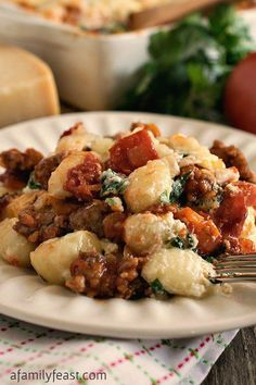 Baked Gnocchi with Italian Sausage - Italian comfort food at its best! Perfect for a weeknight dinner or a special meal!