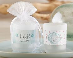 Kate Aspen's personalized frosted glass votives are great wedding favors for your guests. Select a beautiful beach-inspired sticker and customize with your names and wedding details.