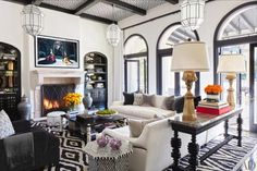 In Kourtney's living room, Christian Liaigre sofas dressed in a Schumacher wool and a Larsen leather are joined by a Steinway piano, a vintage Oscar Niemeyer chair and ottoman from Wyeth, and several custom- designed pieces, among them the ceiling lights, sconce, and consoles. The curtains are of a Loro Piana wool-linen, and the triptych is by Richard Serra.