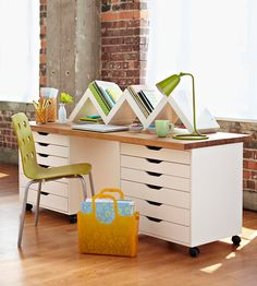 Skip the normal desk and make your own! Using two Alex Drawer Units plus a Vika tabletop (via Ikea) you can easily do this! Attach the tabletop to the rolling drawers using metal L-brackets. Add a Zig Zag bookshelf (via Brianna Kufa Metal Designs) to the top to keep books within reach, add a light and some accessories: done!
