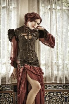 This velvet, suede and leather corset is so beautiful!