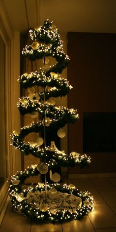 A traditional Christmas tree is the ultimate seasonal decoration. Not only does the presence of a beautifully decorated Christmas tree … Christmas Tree Design, Unique Christmas Trees, Alternative Christmas Tree, Noel Christmas, Xmas Tree, Simple Christmas, Christmas Lights, Christmas Photos, Christmas Centerpieces