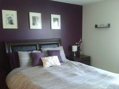 Purple accent wall in grey bedroom. Hmmm