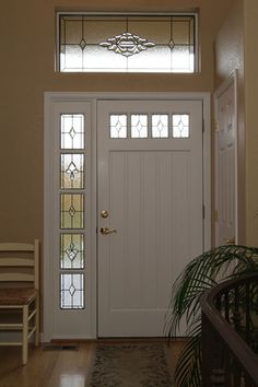 front door with one sidelightWood doors and sidelights with beveled glass create a welcoming