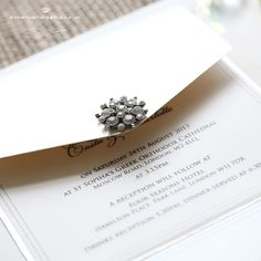 Classic and delicate this wedding invitation features a superb crystal embellishment in silver or gold on a luxurious pearly card in ivory or white.The invitation can be made as a pocket or as a traditional folded card. price starts from £4.99